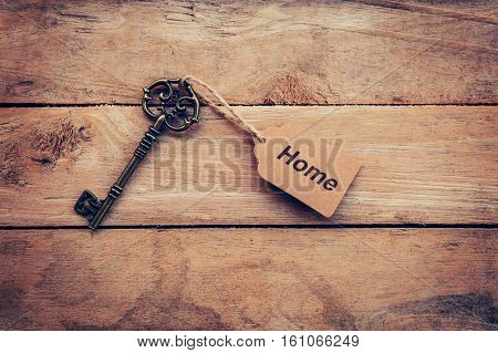 Business Concept - Old Key Vintage On Wood With Tag Home.