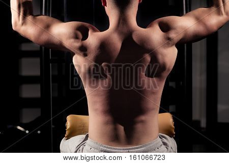 Handsome Man Athlete Doing Pull Ups - Chin-Ups In The Gym.