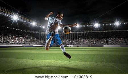 Soccer player kicking ball . Mixed media