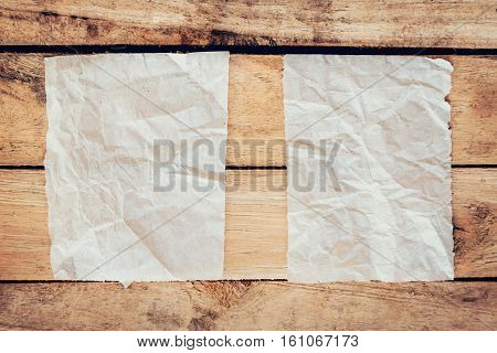 Old Torn Paper And Poster Vintage On Wood Background With Space