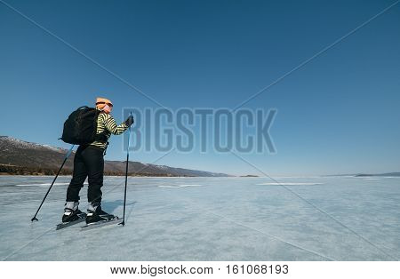 Norwegian hiking skates. Tourists travel to Norway hiking ice skating on the frozen lake. Special long skate for long distances. Mounting under the ski boots. Location of Lake Baikal action. The Russian called Bayes or Loft. An experimental tour skates fo