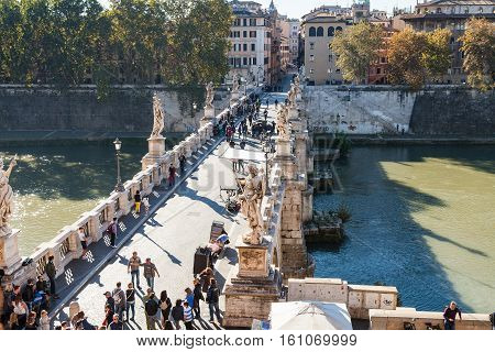 Above View Of Tourists Walk On St Angel Bridge