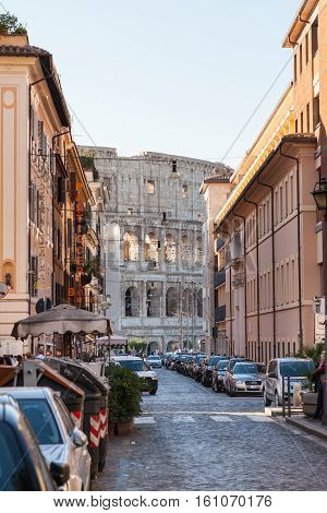 View Of Colosseum Building Through Street In Rome