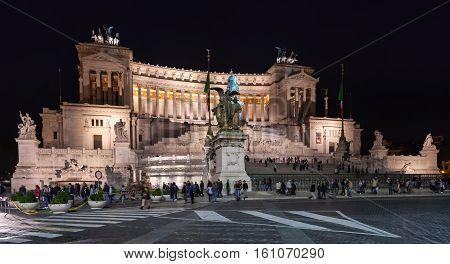 Tourists Near Altare Della Patria In Night