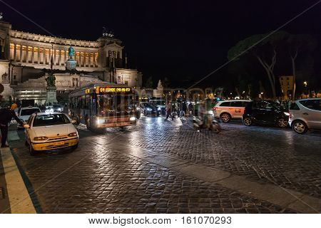 Tourists, Cars, Bus On Piazza Venezia In Rome