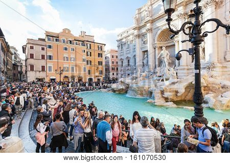 Crowd Of Tourists And Trevi Fountain In Rome City