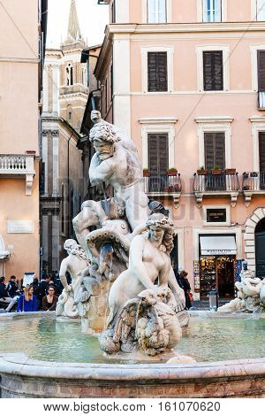 Tourists Near Fountain Of Neptune In Rome