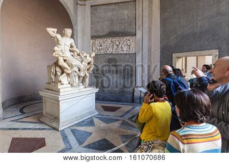 Tourists Near Laocoon Group Statue In Vatican