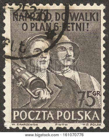 MOSCOW RUSSIA - CIRCA NOVEMBER 2016: a post stamp printed in POLAND shows workers the series