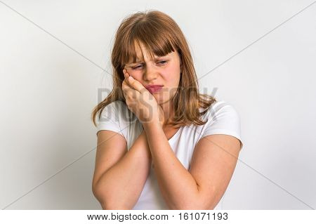 Woman Pressing Her Cheek, She Is Having Toothache