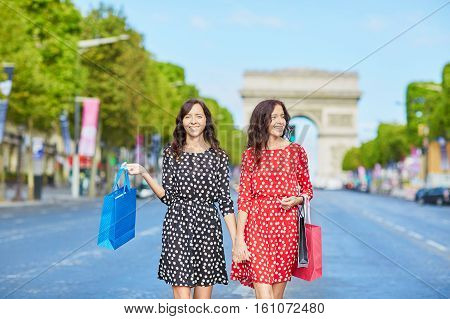 Happy Twin Sisters Doing Shopping On Holidays In France