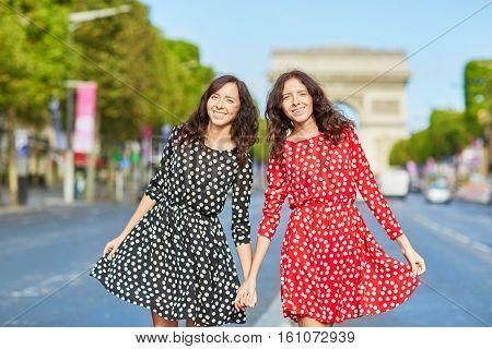 Beautiful Twin Sisters Walkingin Paris