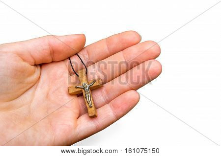 Wooden Cross In Female Hand Isolated On White