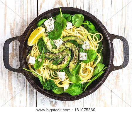 Fettuccine Pasta With Sliced Avocado, Feta Cheese, Spinach
