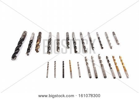 Metal drills of different diameters and lengths isolated. Caliper professional on white background