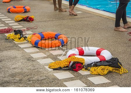 ring buoy and throw bag near side the pool