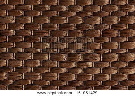 Bamboo woven brown mat handmade background. Wicker wood texture. Horisontal strips.