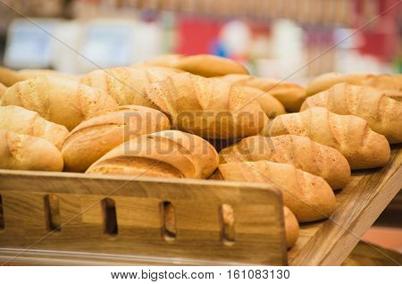 Loaf bread. Many loaves of bread. Background. Loaf bread on supermarket stall