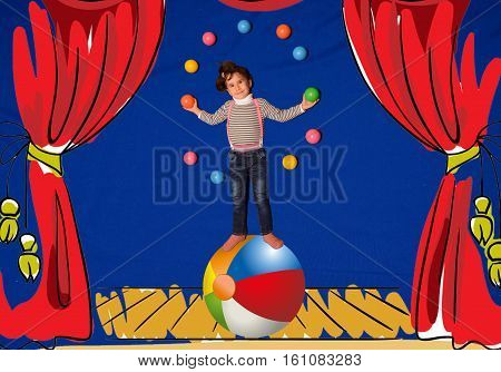 little girl juggles colored balls in a circus standing on the ball