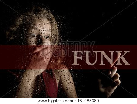 funk written on virtual screen. hand of frightened young girl melancholy and sad at the window in the rain
