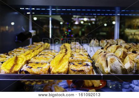 variety of sweets in a shop window