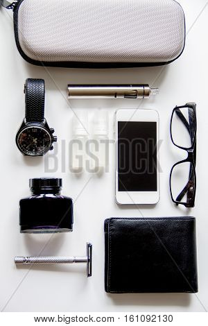 electronic cigarettes and mens accessories on white background top view.