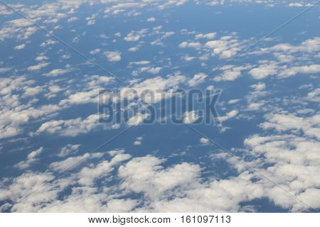 Aerial View Of Blue Sky And Cloud Top View From Airplane Window