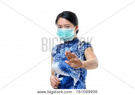 Young Woman In A Face Mask Making A Halt Gesture