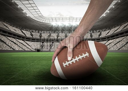 Cropped image of American football player placing the ball against rugby pitch 3D