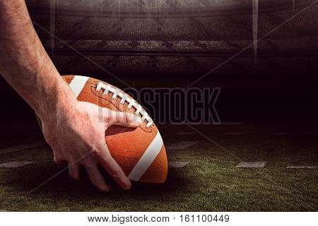 American football player preparing for a drop kick against american football arena 3D