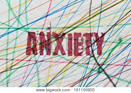 Word Anxiety written on colorful abstract background