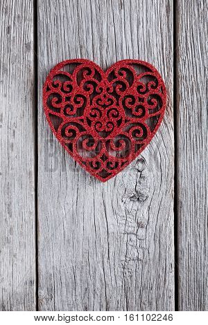 Valentine background with lace red heart shape on rustic wood. Happy lovers day card mockup, copy space. Vertical image