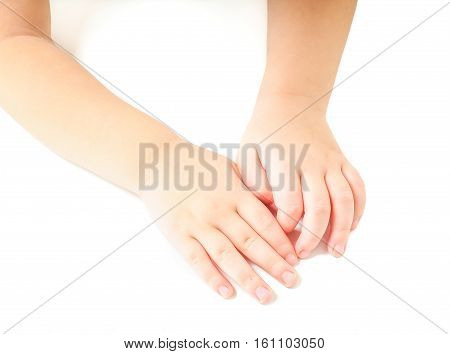 Toddler Leaning Towards On A White Table, With Hands Together
