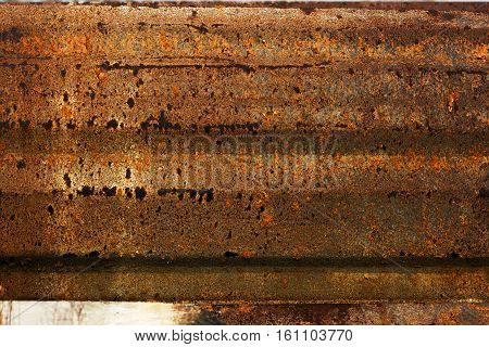 Old rusty vintage spotted metal guardrail background