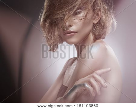Portrait of a beautiful sexy woman with natural make-up. Close-up. Glamour picture