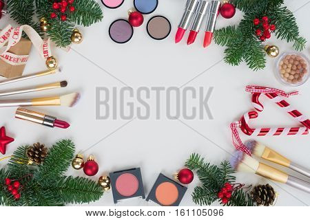 Set of Christmas make up cosmetics products frame with copy space
