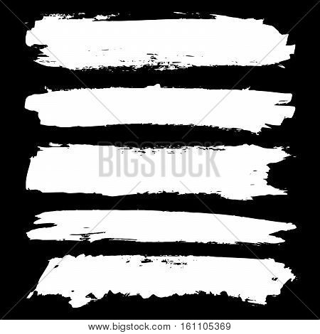 Set of white grunge brushstrokes on black background vector illustration. Abstract handdrawn grunge banners