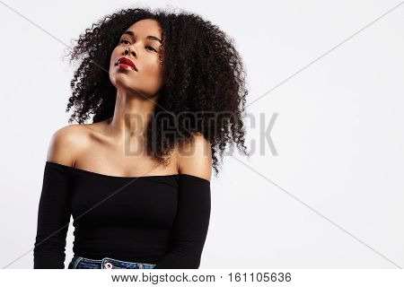Black Woman Wears Bright Glossy Red Lipstick