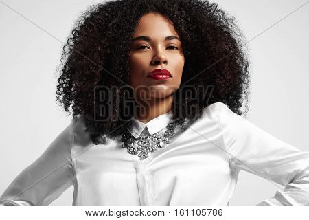 Portrait Of Black Woman Looking At Camera With Afro Hair