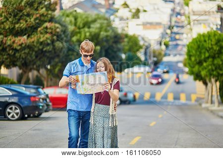 Romantic Couple Of Tourists Using Map In San Francisco, California, Usa