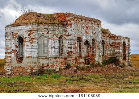 Ruins of church in Romanovo village after destruction in 30 years of XX century. Text on stella: Look back, there was Romanovo village till 1969. Tyumen region