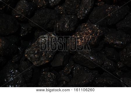 Abstract burn background. Black coal with sparkles