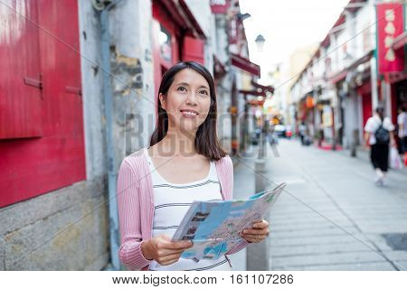 Woman looking for location in Macau city