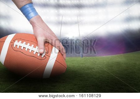 American football player placing the ball against rugby pitch 3D