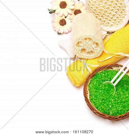 Accessories for peeling and spa. Sea salt, towel, pumice, loofah, body scrubber on white background. Copy space