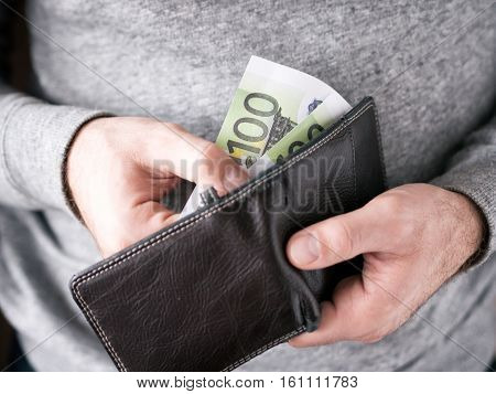 Hands Take Out Euro From Wallet
