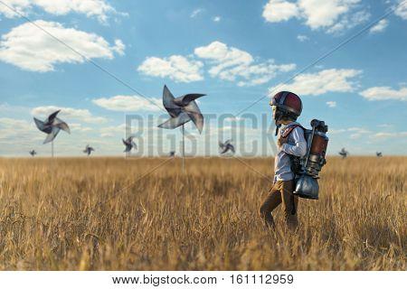 Little boy in helmet in a field