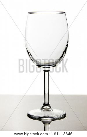 Empty red wine glass isolated on white