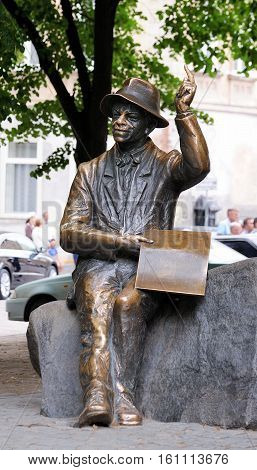LVIV UKRAINE - JUNE 18 2015: Monument of naive painter Nikifor Epifaniusz Drowniak. The monument by sculptor Sergey Oleshko was unveiled in 2006 to commemorate the 111th anniversary of paint