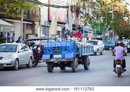 Siem Reap, Cambodia-10 December, 2015. Unidentified Cambodian men are riding old lorry on the town street of Siem Reap in Cambodia on 10 December, 2015.